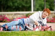 Cooper Creagan '13 puts flags in the ground along Martin's Way