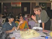 Jinnie Garrett, right, speaks with students at the Asian University for Women in Bangladesh.
