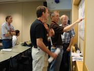 Eugene Domack, (center, pointing)  explains results from IRMS.