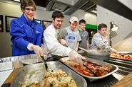 Men's lacrosse team members, from left, Kurt Minges '15, Mike Fiacco '13, Brandon Lew '16, James Hohm '14 and John Zimmerman '15, pack leftover food for the Rescue Mission.