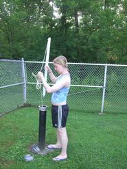 Hanna Kahrmann-Zadak '12 takes her daily sample from a well in Clinton village.