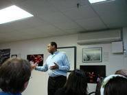 Greg Thomas '85 talks with New York City program students.