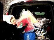 Mary Phillips '11, HAVOC Mitten Tree gift coordinator, loads presents.