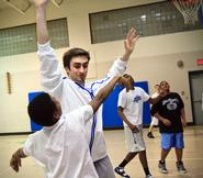 Eric Benvenuti '13 tries to block a shot during a game at the House of the Good Shepherd.