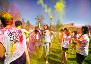 Students throw colored powder at each other during a Holi celebration on the Dunham Green.