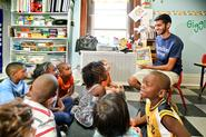 Ishaq Pathan '16 reads to children at Thea Bowman House as part of Hamilton Serves on Wednesday, Aug.29.