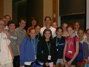 Kristy Kowal, center, with students from Hamilton Swim Camp.