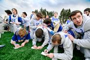 Members of the men's lacrosse team STOPped to write thank you notes.