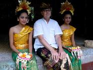 Professor of Theatre Craig Latrell and two dancers, at the wedding of a Ukranian couple in Ubud, Bali.