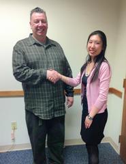 Lisa Yang of Hamilton Microfinance congratulates Joseph Rogers on his new loan.