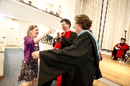 Mary Phillips '11 receives congratulations from Deans Pat Reynolds and Nancy Thompson.