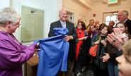 Art Massolo '64 and his wife Karen unveil the plaque in the new Days-Massolo Center.
