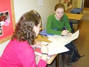 Amelia Mattern '12 (left) and Jane Rouse '12 work on math problems in the hallway at Christian Johnson.