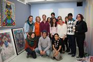 Senior art concentrators and art faculty in Saya Woolfalk's studio.