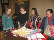 Kate Hails '10, Kenyon Laing '09, Ma Cho and Mu Sa Lee at the Refugee Center.