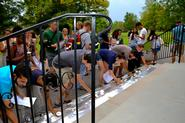 Students place candles on the steps of the Chapel at the conclusion of the 9/11 vigil.