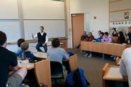 Peter Tague '88 takes questions from students in Erol Balkan's International Finance class.