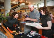 Alumna Katrina Schell '03, left, looks in the time capsule as it is packed by Frank Sciacca and Meg Austin during the 2012 time capsule unveiling on April 23.