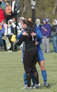 Caitlin McGilley '08 celebrates the win with teammates (Williams sports information photo)