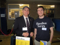 Scott Blosser '12 and Tom Genton '80 representing Hamilton at a college fair in Madrid, Spain