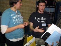 Thea Spittle '12 and Scott Blosser '12 speaking with prospective students at a college fair in Madrid, Spain