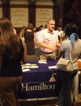 Kyle Graham '06 representing Hamilton at a college fair.