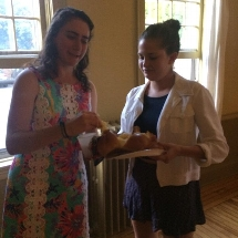 Ellie Pinto '18 and Liza Strauss '15 say the blessing over the challah.