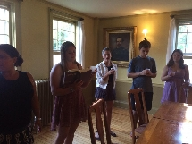 Rachel Landman '15 leads a service at our weekly Shabbat.