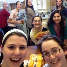 Students having fun cooking mac n' cheese for Shabbat.
