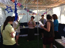 Celebrating Sukkot in our very own sukkah.