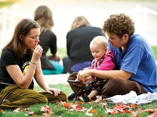Scholar in Residence Brandon Zimmerman, wife Rebecca and daughter Anasthasia snack during the Senior Gift Kickoff Reception. (PHOTO BY NANCY L. FORD)