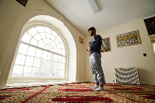 Shakil Hossain (&apos;14) prays in the new muslum prayer room on the 2nd floor of the Chapel. The carpet, which faces Mecca, was donated by the Court Street Mosque in Utica.<br />Photo: Nancy L. Ford