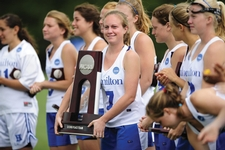 Co-Captain Kayla Bettenhauser '10 with the NCAA second-place trophy.