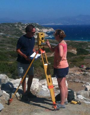 Adriana Fracchia '14 and Professor John McEnroe on site in Gournia using the Topcon Total Station.