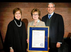 Distinguished Service Award recipient Cathy Brown, center, with Hamilton President Joan Hinde Stewart and Alumni Association President John Hadity '83.