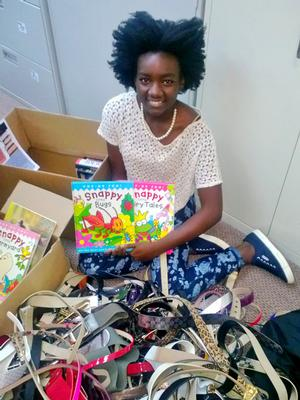 Jorett Joseph '15 sorts donated books and belts for the orphanage she's working with in Haiti.