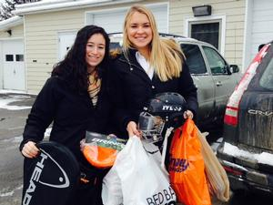 Samantha Sherman '15 and Katie Steates '15 prepare to deliver sports equipment to the House of Good Shepherd.