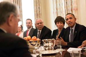 Thomas Tull '92, back left, seated next to retired Gen. Colin Powell, at the White House discussion of President Obama's