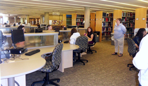 Research Librarian Kristin Strohmeyer assists local high school students in Burke Library.