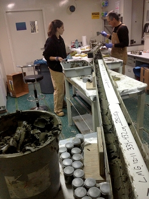 Professor Domack and Deanna Nappi '15 working to sample and preserve Jumbo Kasten Core (JKC) 15 in the starboard lab on the LMG. The core was 10.5 meters long and required a special table arrangement.