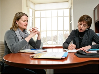 Mary McLean Evans '82 (right), interim executive director of the Career Center, confers with Abby Taylor, the center's associate director of employer relations.
