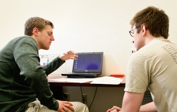 Peer advisor Taylor Hogenkamp '13 (left) and visitor Mac Mahoney '14 consider options during a visit by Mahoney to the Career Center's Bristol Center offices this spring.