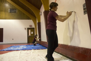 Dilyana Mihaylova '12 (left) and Mercedes Virginia Ferrer '12 (right) paint during Make a Difference Day.