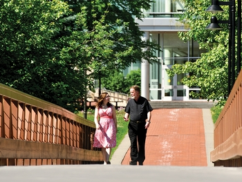 Father John Croghan and Cathy Crone '13 take a stroll along Martin's Way.