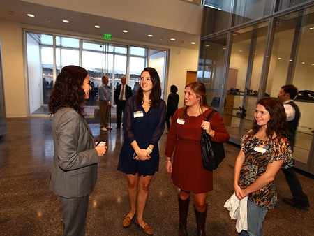 Tracy Adler, director of the Wellin Museum of Art, welcomes alumnae (PHOTO BY JOHN BENTHAM)