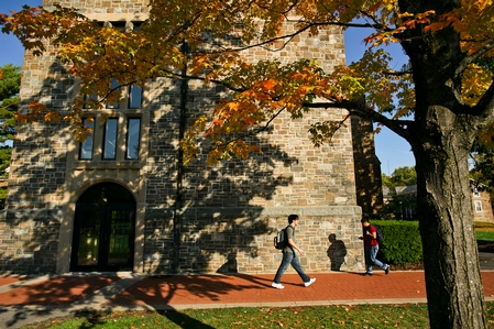 Students walk past Christian A. Johnson Hall.  (PHOTO BY NANCY L. FORD)