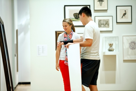 Student docent Mackenzie Leavenworth '15 discusses artwork with Kang Hyuk '16 during the opening of the Ruth and Elmer Wellin Museum of Art. (PHOTO BY NANCY L. FORD)