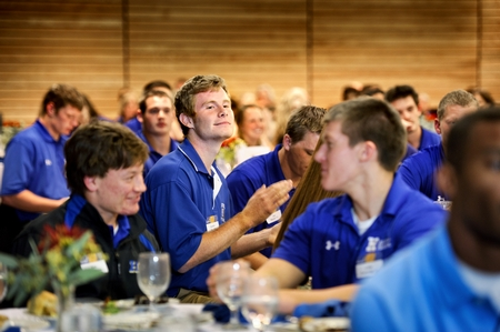 Students applaud at remarks during the football banquet. (PHOTO BY NANCY L. FORD)