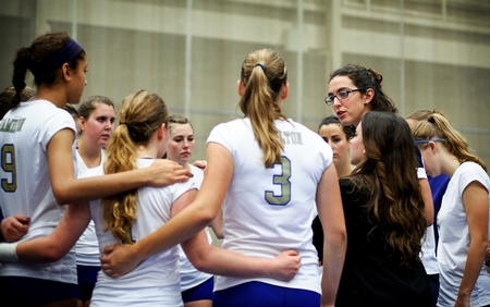The volleyball team huddles in between games. (PHOTO BY MEGAN P. HAMAN)