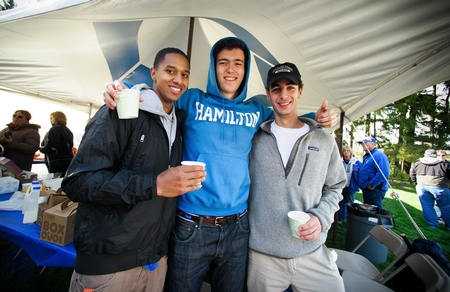 Thomas Figueroa '15, Matt Magruder '15 and Marc Dudzik '16 pose for a photo during the tailgate party. (PHOTO BY MEGAN P. HAMAN)